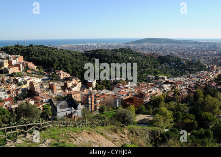 view of Barcelona from the mountain up to the top of the parc de la creueta del Coll with Montjuic mountain on the - Stock Photo