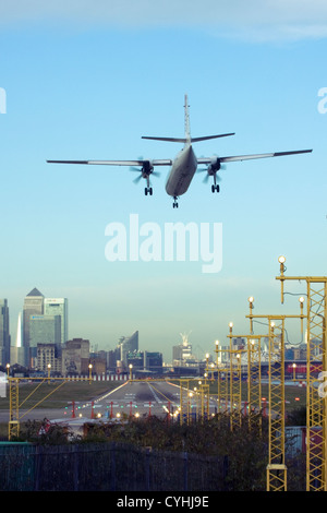 Regional airliner Landing at London City Airport, England, UK - Stock Photo