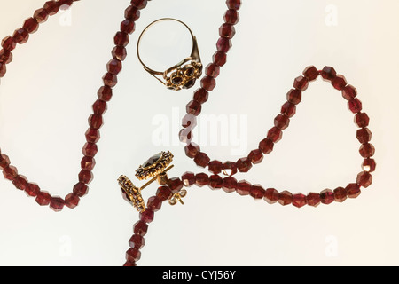 Garnet Necklace, Earrings and Ring on White Background