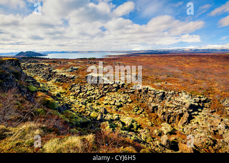 Thingvellir national park is the site of a rift valley that marks the crest of the Mid-Atlantic Ridge - Stock Photo