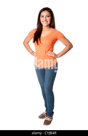 Beautiful happy smiling confident teenager young woman standing with hands on hip wearing orange shirt and blue - Stock Photo