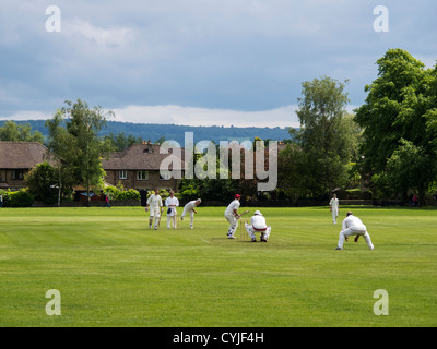 Cricket match a popular and traditional English game being played in Bakewell Derbyshire England - Stock Photo