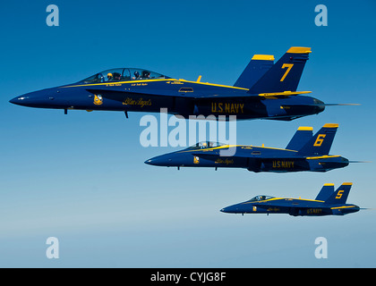 A formation of US Navy Blue Angel FA-18 Hornets fly together September 20, 2012 over Altus Air Force Base, Oklahoma. - Stock Photo