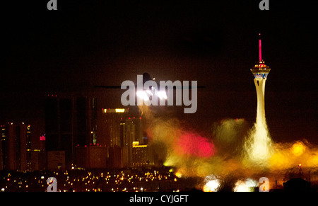 A B1-B Lancer stealth bomber aircraft takes off at night toward the Las Vegas Strip October 30, 2012 at Nellis Air - Stock Photo
