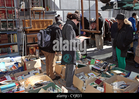 Bric-a-Brac furniture books and second hand items for sale, El rastro Sunday street market, Madrid, Spain. - Stock Photo