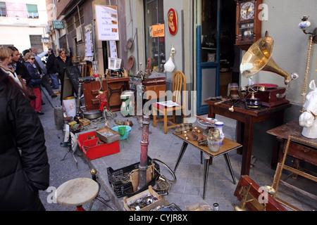 Bric-a-Brac antiques second hand items for sale, El rastro Sunday street market, Madrid, Spain. - Stock Photo