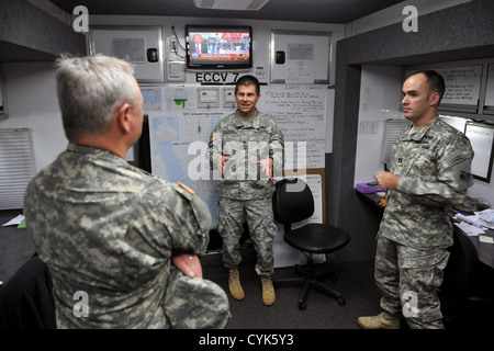 Army Gen. Frank Grass, the chief of the National Guard Bureau, is briefed on the U.S. Army Corps of Engineers' work - Stock Photo