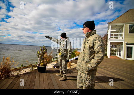 New Jersey Air National Guardsmen from the 108th Wing provide security overwatch of the bay to look for potential - Stock Photo