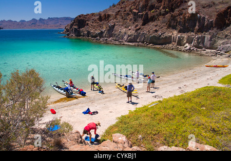 Mexico, Baja, Sea of Cortez. A sea kayaking rest stop at azure-colored Honeymoon Cove on Isla Danzante. (MR) - Stock Photo