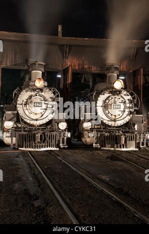 1925 2-8-2 Mikado type Baldwin Steam Locomotives at Durango and Silverton Narrow Gauge Railroad Depot at night. - Stock Photo