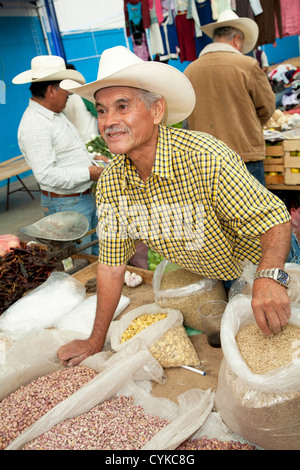 North America, Mexico, Guanajuato State, Guanajuato, elderly man selling beans and rice in market. UNESCO World - Stock Photo