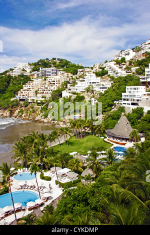 Acapulco, Mexico, Guerrero, resorts, homes, mansions and hotels line the hills along the beach of Acapulco - Stock Photo