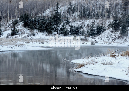 Reflections in open water above the beaver dam on Junction Creek in early winter, Greater Sudbury, Ontario, Canada - Stock Photo