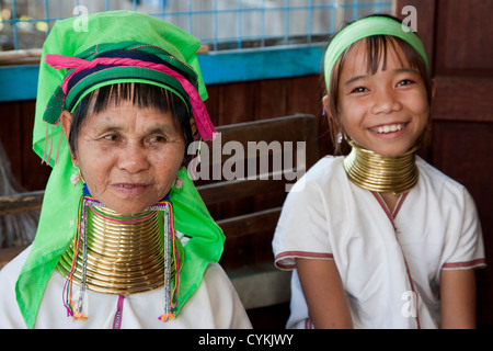 Myanmar, Burma. Padaung Women with Brass Neck Coils, Inle Lake, Shan State. The Padaung are also called Kayan Lahwi. - Stock Photo