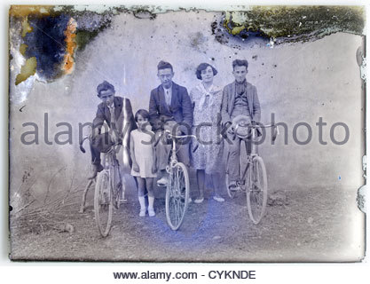 eroding glass plate image with family and their bicycles - Stock Photo