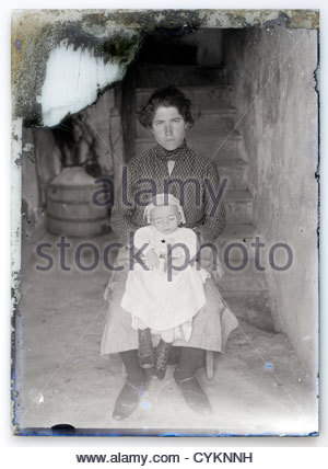 eroding glass plate with memorial portrait of young mother posing with dead baby - Stock Photo