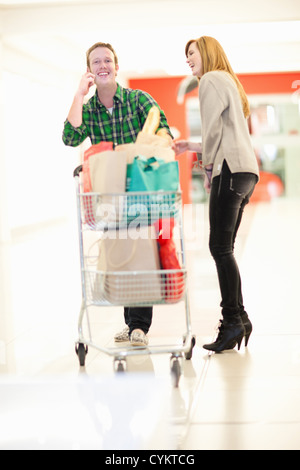 Couple shopping together in mall - Stock Photo