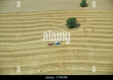 Aerial view of tractor in crop field - Stock Photo