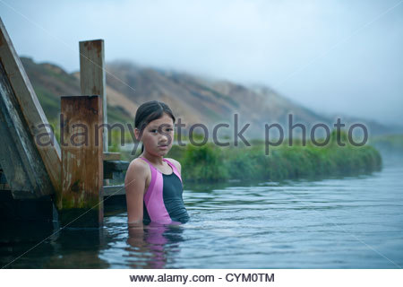 Girl relaxing in geothermal spring - Stock Photo