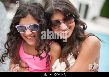 Mother and daughter wearing sunglasses Stock Photo