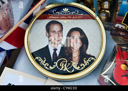 Prince William and Kate Middleton - a souvenir cake tin at a royal wedding street party, UK, in 2011 - Stock Photo