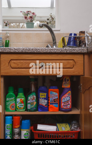 Cleaning Products And Cloths; Kitchen And Household Cleaning Products  Sitting On A Shelf In A Kitchen Cupboard.   Stock