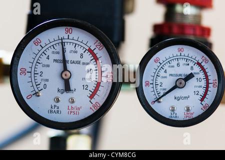 pressure gauges monitoring pipelines - Stock Photo