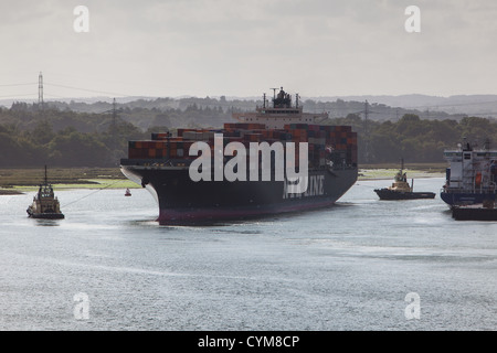 Container ship in southampton harbour waters England - Stock Photo