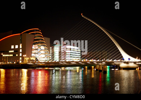 view of the samuel beckett bridge over the river liffey and the convention centre dublin at night dublin republic - Stock Photo