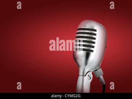 Retro style microphone.Red background - Stock Photo