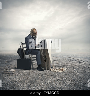 business wearing a gas mask, write with an old typewriter - Stock Photo