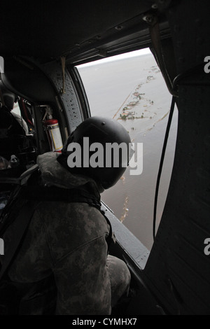 Aviators of the 1-150th Assault Helicopter Battalion, New Jersey Army National Guard, search for stranded New Jersey - Stock Photo