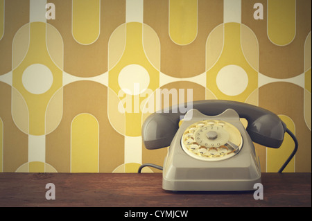 Old-fashioned phone on vintage background - Stock Photo