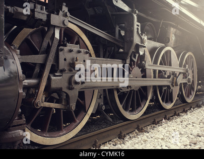 Old locomotive wheels close up. - Stock Photo