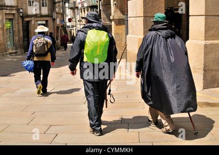 Spain, Galicia: St. James pilgrims arriving in Santiago de Compostela - Stock Photo