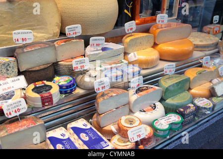 Cheese shop window in central Madrid, showing huge range selection of European cheeses, Spain. - Stock Photo