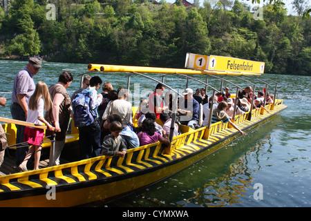 Yellow boat in Rhine river in Switzerland - Stock Photo