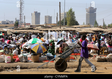 Old-Soweto market in Lusaka, Zambia. Skyscrapers of the city in the background, Findeco house at the right - Stock Photo