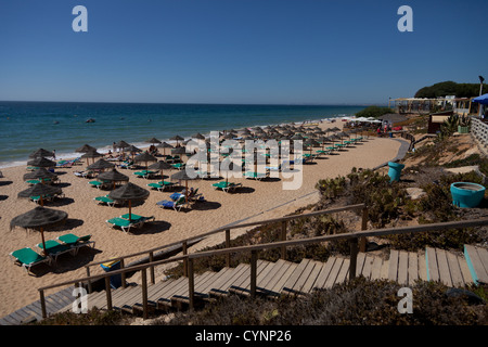 Rows of empty sun loungers at end of season on the Portuguese, Algarve coast - Stock Photo