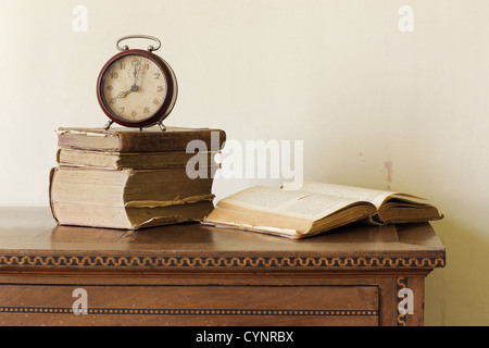 old alarm clock on old books, copy space - Stock Photo