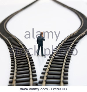 Toy rail track with small figure of male - Stock Photo