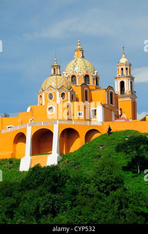 Church of Neustra Senor de los Remedios or Our Lady of Remedios on wooded hillside above the pyramid ruins with - Stock Photo