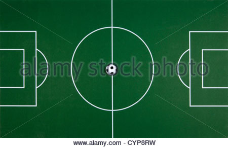 Toy football pitch with small football - Stock Photo