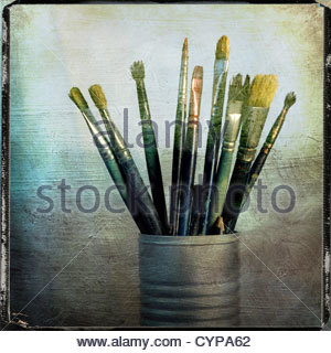 Artists brushes in container - Stock Photo