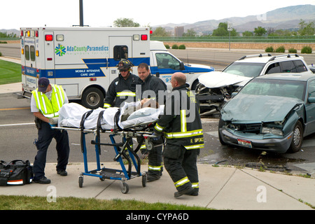 Paramedics and firefighters respond to an automobile injury accident in Boise, Idaho, USA. - Stock Photo