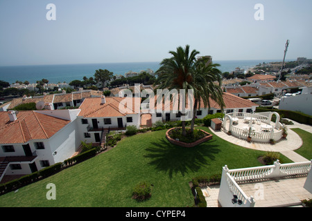 Cost del Sol, Spain. View from the balcony of an apartment  in Calahonda, overlooking a palm tree, a swimming pool - Stock Photo