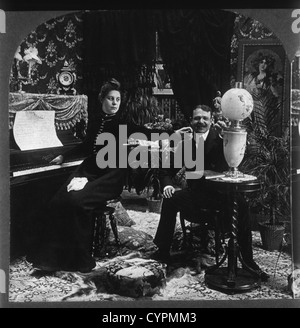 Man and Woman in Victorian Parlor, Stereo Photograph, Circa 1900 - Stock Photo
