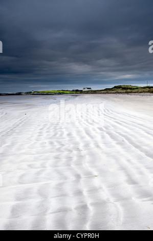 Waves in the sand on Salum beach, Isle of Tiree, Inner Hebrides, Scotland. - Stock Photo