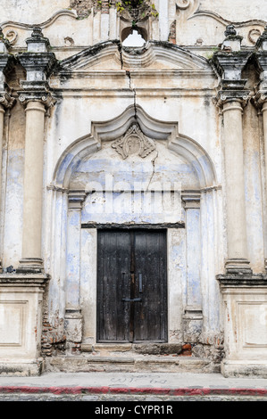 A doorway onto the street from the monastery and church of Santa Clara (Saint Clair) in Antigua, Guatemala. The - Stock Photo