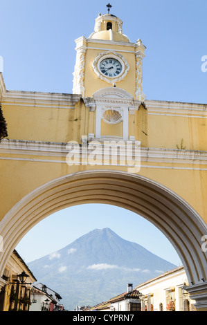 The Volcan de Agua can be seen under the arch at the Santa Catalina in Antigua, Guatemala. - Stock Photo
